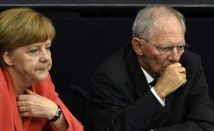 La chancelière allemande Angela Merkel et le ministre des Finances Wolfang Schäuble, sur les bancs du Parlement lors d'un débat à Berlin, le 17 juillet 2015