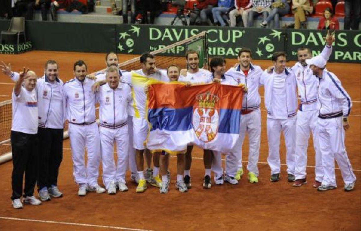 La Serbie s'est qualifiée pour les quarts de finale de la Coupe Davis après le succès de la paire Viktor Troicki/Nenad Zimonic sur le duo belge Steve Darcis/Ruben Bemelmans 6-4, 6-4, 5-7, 6-4 samedi à Charleroi. – John Thys afp.com