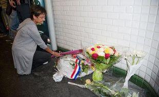 """Dépôt de gerbe station Crimée en mémoire de """"Babu"""", le 5 octobre 2011."""