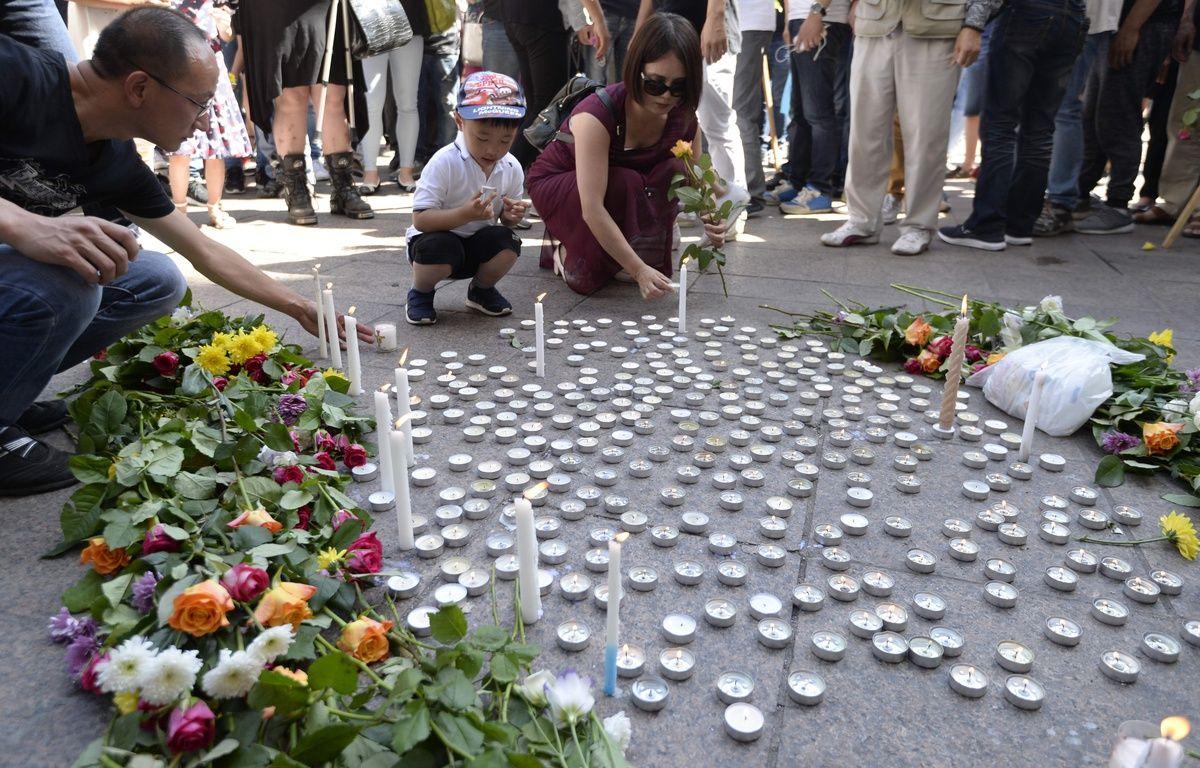 Hommage le 14 août 2016 à Aubervilliers à Zhang Chaolin. – ALAIN JOCARD / AFP