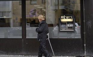 Le spectaculaire rétablissement économique de l'Islande, au bord de la banqueroute il y a trois ans, enseigne qu'un gouvernement doit laisser les banques faire faillite plutôt que de s'attaquer au contribuable, relèvent des analystes