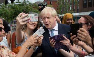 Mandatory Credit: Photo by Geoff Pugh/REX (10348164w) Prime Minister Boris Johnson with Home Secretary Priti Patel join local police on a visit to North Road, Harbourne. Prime Minister and Home Secretary visit local police, Birmingham, UK - 26 Jul 2019/Rex_Prime_Minister_and_Home_Secretary_visit_lo_10348164W//1907270115