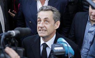 Nicolas Sarkozy avant son vote pour la présidence de l'UMP à Paris le 29 novembre 2014