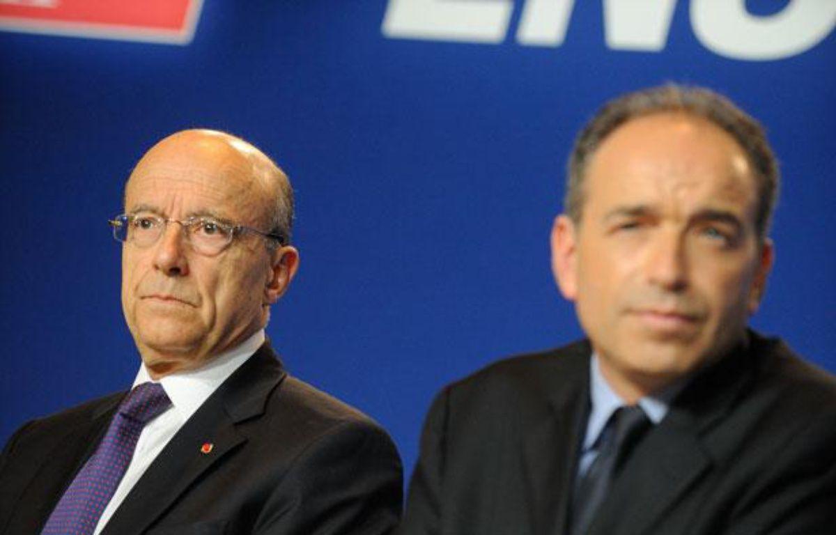Alain Juppé et Jean-François Copé, le 26 mai 2012 à Paris. – WITT/SIPA
