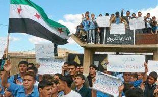 Protestation contre le régime syrien à Hula, près de Homs, le 24 octobre.