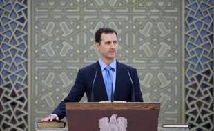 Photo fournie par l'agence de presse officielle syrienne montrant le président Bachar al-Assad lors de la cérémonie d'investiture pour son nouveau mandat, le 16 juillet 2014 à Damas
