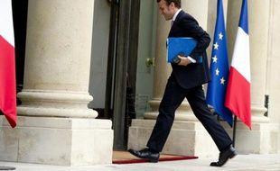 Le ministre des Finances Emmanuel Macron à son arrivée le 7 octobre 2014 à l'Elysée à Paris