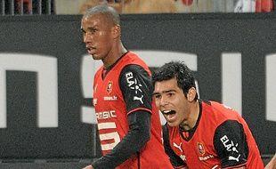 Emerson (à g.), ici avec Silvio Romero.
