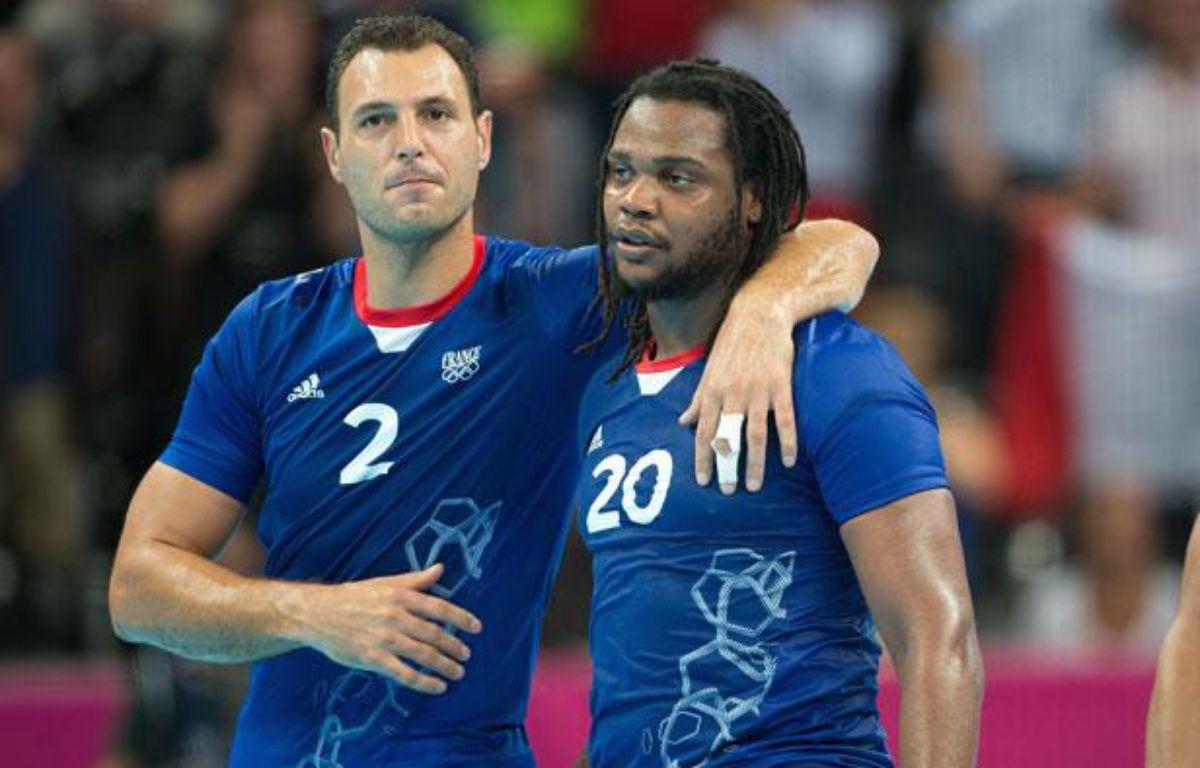 Jérôme Fernandez et Cédric Sorhaindo après la victoire de l'équipe de France de handball sur la Croatie en demi-finales des jeux Olympiques (25-22), le 10 août 2012 à Londres. – Chamussy Nivière/SIPA