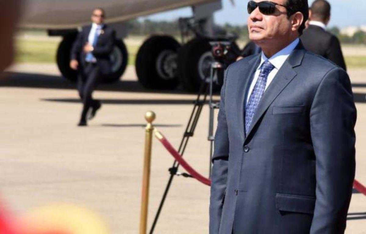 Le président égyptien Abdel Fattah al-Sissi à l'aéroport Houari-Boumediene le 25 juin 2014 à Alger – Farouk Batiche AFP