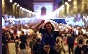 People celebrate on the Champs Elysees avenue, with the Arc de Triomphe in background, to celebrate after the semifinal match between France and Belgium at the 2018 soccer World Cup, Tuesday, July 10, 2018 in Paris. France advanced to the World Cup final for the first time since 2006 with a 1-0 win over Belgium on Tuesday.