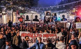 People hold banners and victim portraits as they demonstrate in Marseille city centre on November 14, 2018 to protest against unsafe and unsanitary housing conditions ahead of the city hall, a week after two dilapidated buildings collapsed in the working-class district of Noailles, just a few steps from the bustling port.
