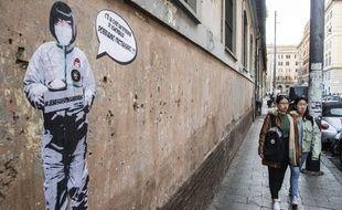 Une peinture évoque de coronavirus sur un mur de Rome.