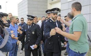 Neuf des dix-sept policiers poursuivis ont été acquittés.