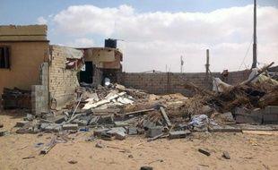 Des bâtiments abîmés dans le village d'al-Toma, dans le Sinaï, après une attaque de l'armée égyptienne, le 3 septembre 2013