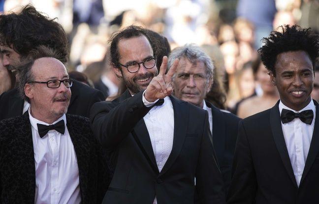 Michel Toesca, Cédric Herrou et Ali Aboubakar, réfugié tchadien, le 17 mai 2018 sur le tapis rouge du Festival de Cannes