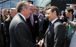 François Bayrou et Nicolas Sarkozy, à Bordes, dans les Pyrénées-Atlantiques, le 22 juin 2010.