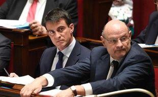 Le Premier ministre Manuel Valls et le ministre chargé des Relations avec le Parlement Jean-Marie Le Guen le 28 avril 2014 à l'Assemblée nationale à Paris