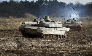 Entraînement avec un char Leclerc au Centre d'entraînement aux actions en zone urbaine, à Sissonne, le 29 novembre 2012.