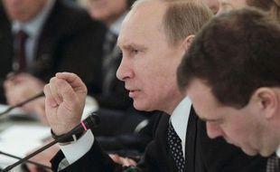 """L'ex-ministre russe des Finances, Alexeï Koudrine, a affirmé mardi que le Premier ministre Vladimir Poutine était prêt à un """"dialogue"""" avec l'opposition et à la tenue en mars d'une présidentielle """"honnête"""", face à une contestation sans précédent des législatives russes."""