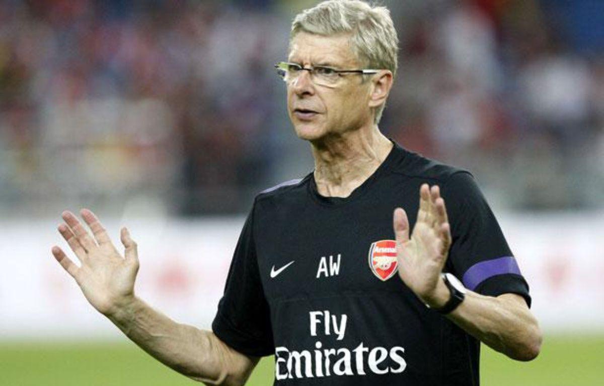 Arsène Wenger avant un match d'Arsenal lors de la préparation estivale, le 23 juillet 2012 en Malaisie. – L.Seng Sin/SIPA