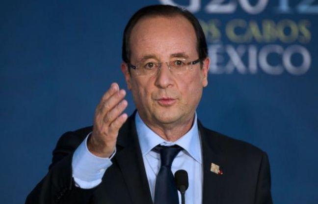 """Le président français François Hollande a affirmé que la taxe sur les transactions financières entrerait """"en vigueur"""" au cours de l'année 2013, mardi lors d'une conférence de presse à Los Cabos (Mexique), à l'issue du sommet du G20."""