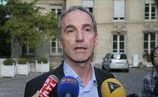 Le président de la Fédération nationale des producteurs de lait, Thierry Roquefeuil à l'issue d'une réunion  avec Stéphane Le Foll, le 23 juillet 2015 au ministère de l'Agriculture à Paris