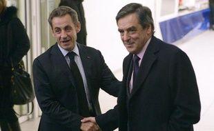 Nicolas Sarkozy et François Fillon au siège de l'UMP le 2 décembre 2014 à Paris