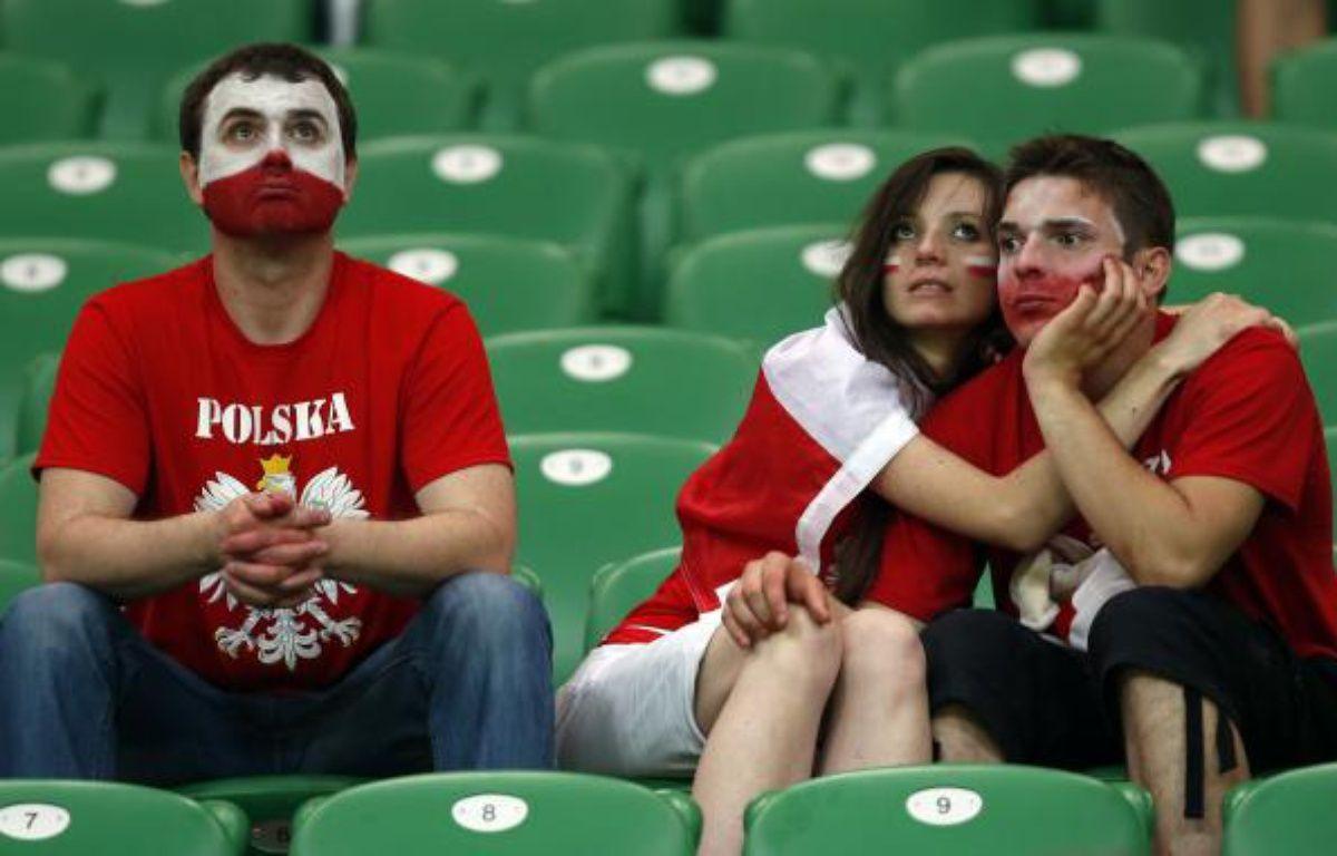 Des supporters polonais après l'élimination de leur pays, le 16 juin 2012 à Wroclaw. – S.Perez / REUTERS