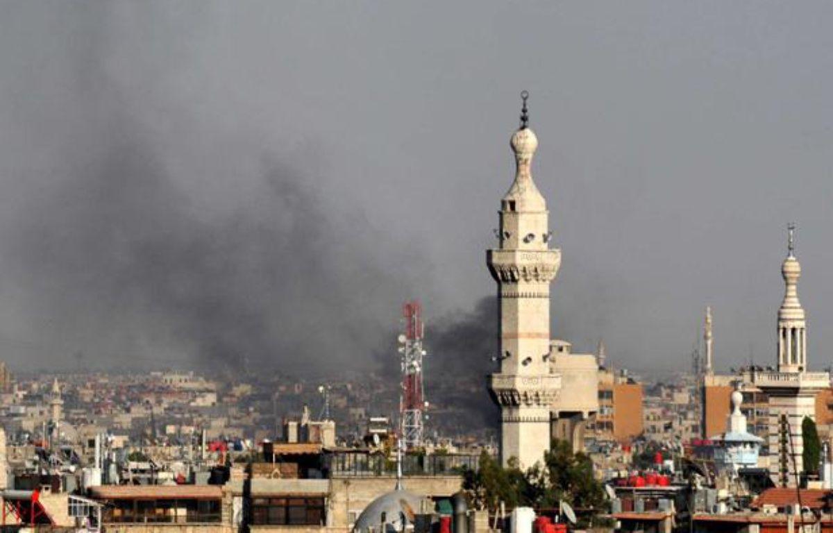 La ville de Damas, enSyrie, a été le théâtre d'un attentat à la bombe contre un bâtiment de la Sécurité nationale, le 18 juillet 2012. – AP/SIPA