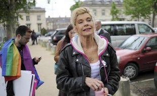 """Frigide Barjot, porte-parole de la Manif pour tous qui appelle à défiler dimanche à Paris contre le mariage homosexuel, a confirmé samedi à l'AFP qu'elle ne serait """"ni dans le cortège ni sur le podium"""" en raison du climat de violence."""