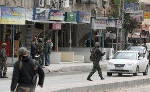 L'attaque à la bombe menée dimanche par des rebelles contre une base de l'armée près de Damas a fait 48 morts, selon un bilan revu à la hausse lundi par l'Observatoire syrien des droits de l'Homme (OSDH).