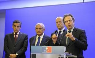 Francois Fillon, Jean Pierre Raffarin, Alain Juppe and Luc Chatel. Mayor of Bordeaux Alain Juppe acting as interim president part of a triumvirate leading the French right-wing UMP party, gives a press conference with  former French Prime Ministers Francois Fillon and Jean-Pierre Raffarin and the party's interim General Secretary Luc Chatel. Paris, FRANCE-08/07/2014/WITT_Choix016/Credit:WITT/SIPA/1407082131