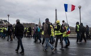 Des «gilets jaunes» manifestent à Paris le 26 janvier 2019.