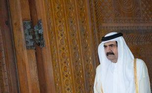 """Le nouvel émir du Qatar, cheikh Tamim ben Hamad Al-Thani, a affirmé mercredi vouloir de bonnes relations avec """"tous les pays"""" et formé un nouveau gouvernement remplaçant celui de l'influent Hamad ben Jassem Al-Thani, acteur clé dans la diplomatie dynamique du petit émirat."""