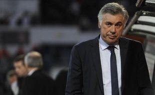 """L'entraîneur italien Carlo Ancelotti, 54 ans, débarque au Real Madrid avec une mission sportive, décrocher la fameuse """"decima"""", la dixième Ligue des champions du club, et une plus diplomatique, convaincre Cristiano Ronaldo de rester."""