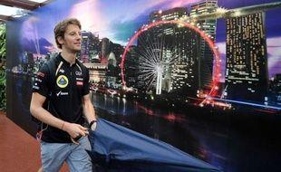 """Le pilote français de l'écurie Lotus, Romain Grosjean, a repris le volant de sa Lotus de Formule 1 vendredi lors des essais libres du Grand Prix de Singapour, après un GP de suspension, en Italie, puis a expliqué que sa priorité est désormais de """"marquer des points"""" pour Lotus."""