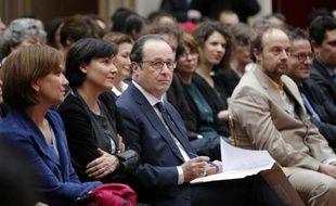 """François Hollande lors de la cérémonie """"La France s'engage"""" le 10 mars 2015 à l'Elysée à Paris"""