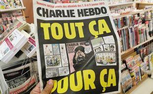 """La veille du procès """"Charlie Hebdo"""", le journal a décidé de republier les caricatures de Mahomet en titrant """"Tout ça pour ça""""."""