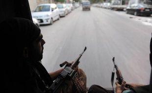 """Les rebelles syriens ont accusé le régime d'avoir transféré des armes chimiques près des frontières du pays au lendemain de la menace de Damas de s'en servir en cas """"d'agression extérieure""""."""