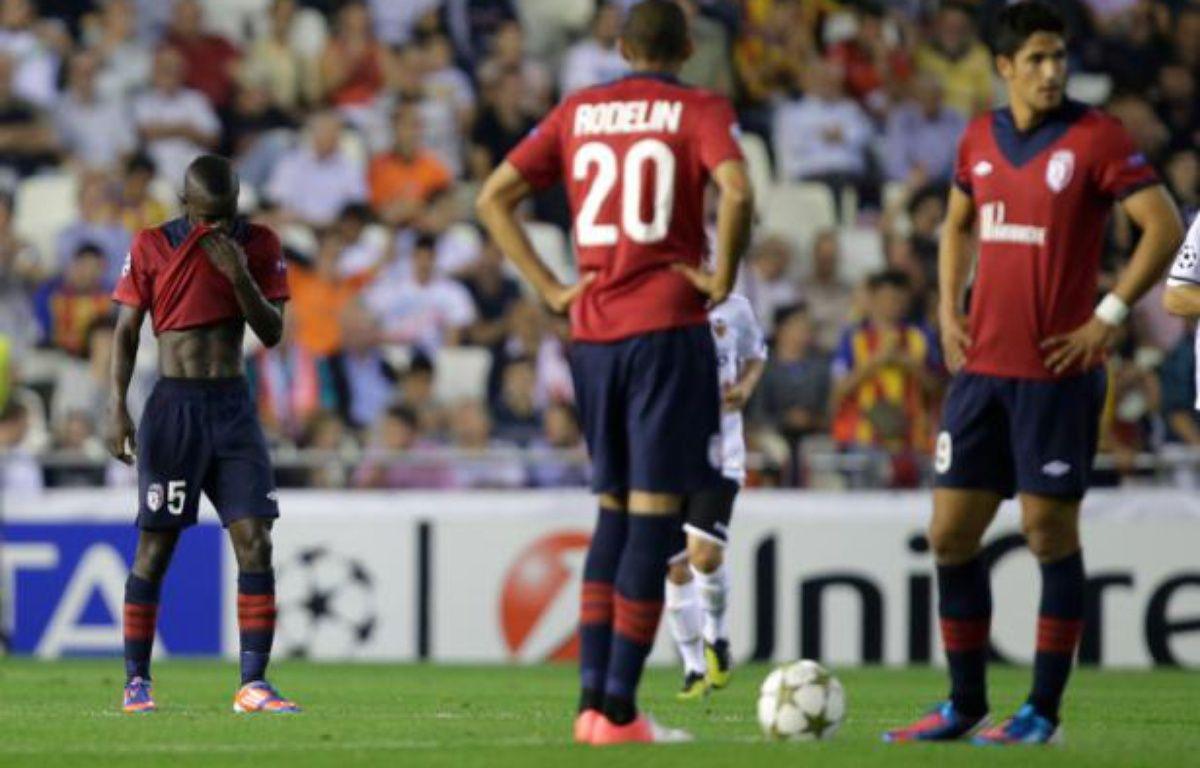 Les joueurs de Lille, lors de la défaite du Losc vontre Valence 2-0 en Ligue des champions, le 2 octobre 2012. – J.JORDAN/AFP