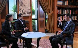 """Le président syrien Bachar al-Assad a lié mercredi son départ à une """"décision du peuple"""", laissant entendre qu'il pourrait se présenter à la prochaine élection présidentielle prévue en 2014, alors que son pays est ravagé depuis deux ans par un conflit meurtrier."""