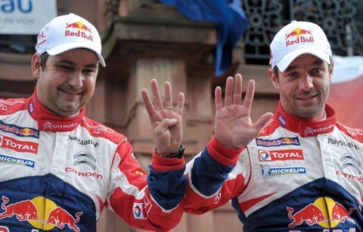 Le Français Sébastien Loeb est devenu champion du monde des rallyes pour la neuvième fois de sa carrière à l'issue du rallye de France, 11e des 13 manches du championnat WRC, qu'il a remporté dimanche à Haguenau (est). – Frederick Florin afp.com