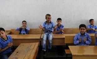Jour de rentrée des classes pour de jeunes Palestiniens dans une école des Nations Unies à Gaza City le 14 septembre 2014