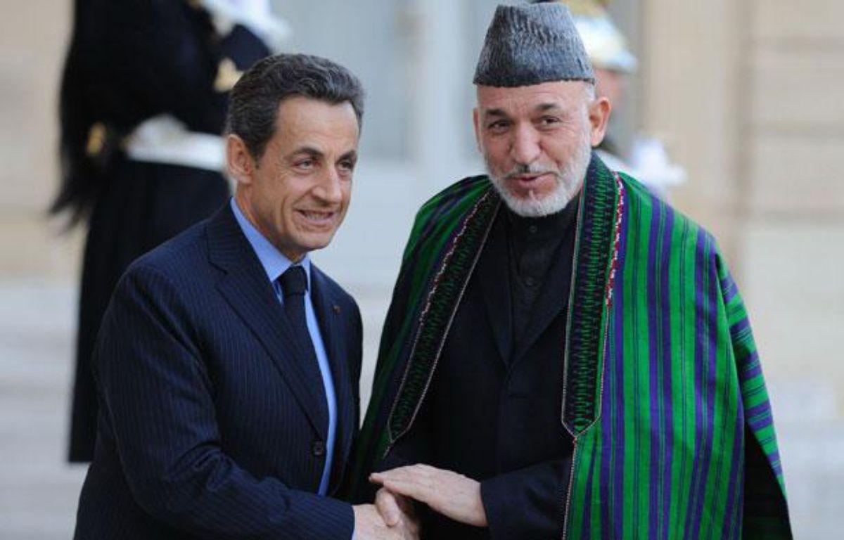 Nicolas Sarkozy et Hamid Karzai à l'Elysée, à Paris, le 27 janvier 2012. – WITT/SIPA