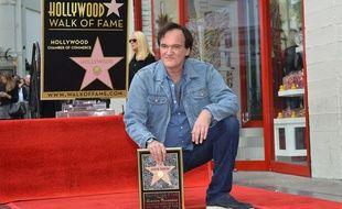 Quentin Tarantino inaugure son étoile sur le Walk of Fame, le 21 décembre 2015. AFP PHOTO /ANGELA WEISS