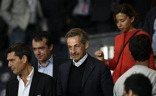 L'ancien président Nicolas Sarkozy pendant un match entre le PSG et le Gazélec Ajaccio le 16 août 2015 au Parc des Princes à Paris