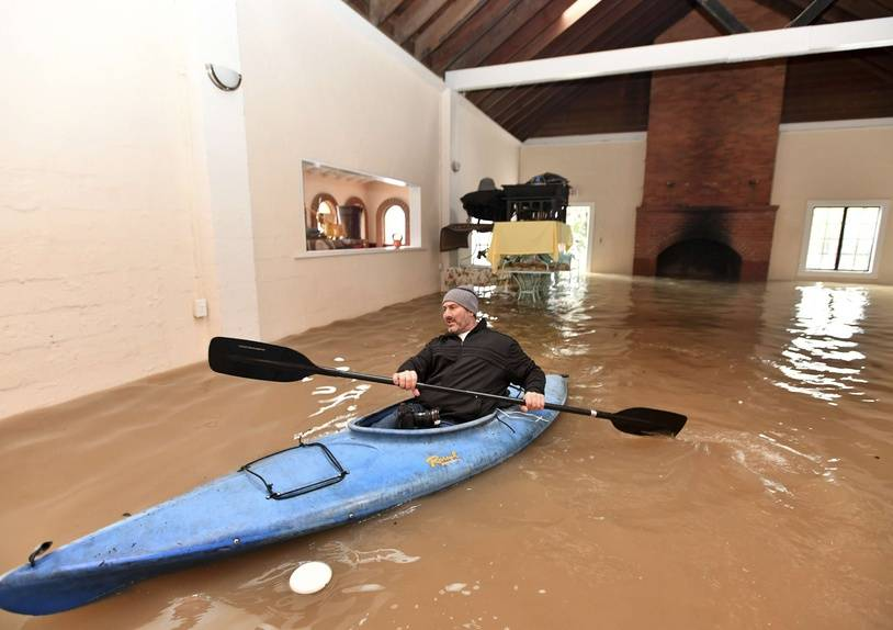 Jay Michael Tucker kayaks through the flooded Surrey Resort as the Russian River flows through it in Guerneville, Calif., Friday, Feb. 15, 2019. Streets and low-lying areas flooded as the Russian River swelled above its banks Friday. (AP Photo/Josh Edelson)/CAJE115/19046833039812/1902160034