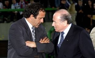 TIONAL SQUAD IN SARAJEVO.MICHEL PLATINI CHATS TO PRESIDENT OF FIFA STEPP BLATTER BEFORE THE FRIENDLY MATCH.