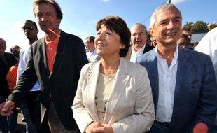 La première secrétaire du Parti socialiste Martine Aubry arrive accompagnée de (GàD) de Francis Parny (PCF), Jean-Paul Huchon (PS) et de Claude Bartolone, le 13 septembre 2009 à La Courneuve près de Paris, lors de la Fête de l'Humanité.